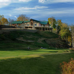 exterior view of pete dye river course clubhouse