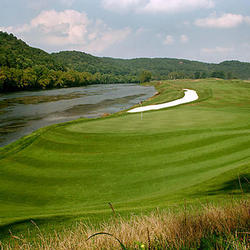 golf hole next to the river at pete dye river course