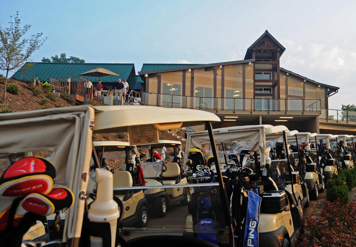 golf carts lined up in front of pete dye river course clubhouse